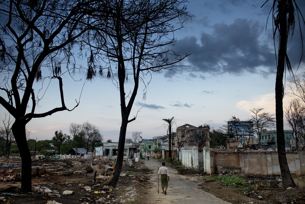 A Muslim man walks through the ruins what weeks before was a Muslim neighbourhood. It was destroyed by Burmese extremist in anti-Muslim riots, Meiktila / Burma - 2013