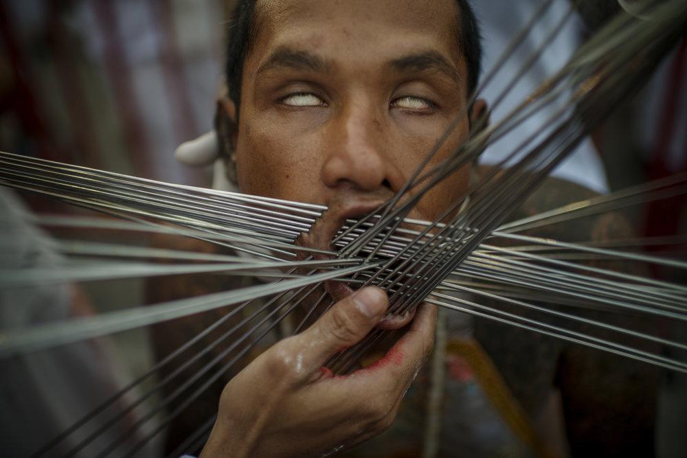 Man pierced with needles, The Nine Emperor Gods Festival, Phuket/ Thailand