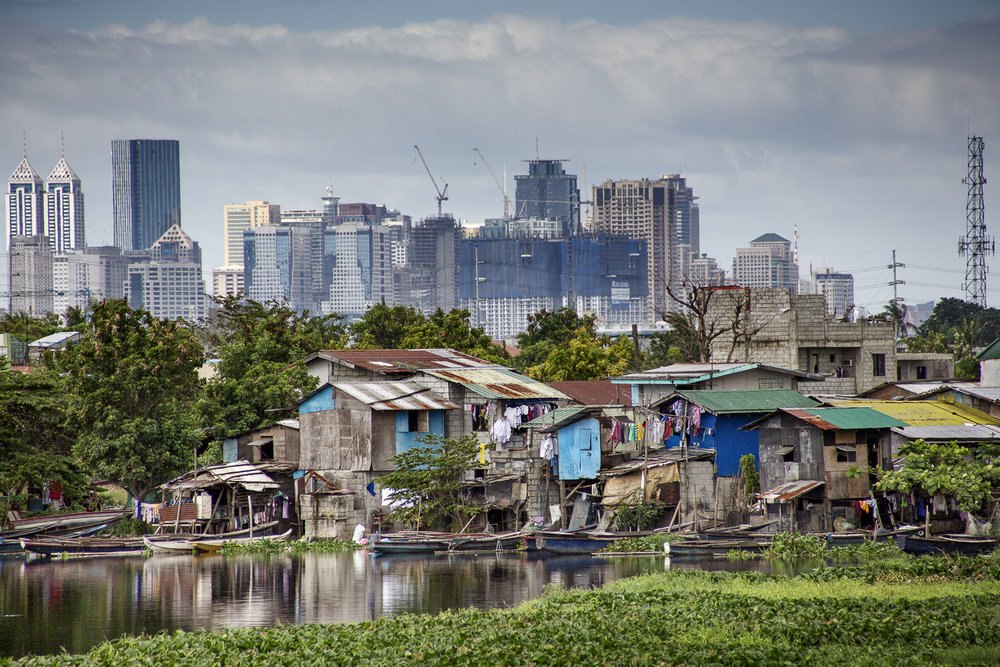 Slum with Manila skyline in the backdrop / Philippines- 2016