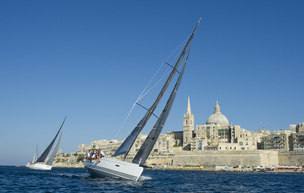 A yacht tilting in the wind whilst entering marsamxett harbour
