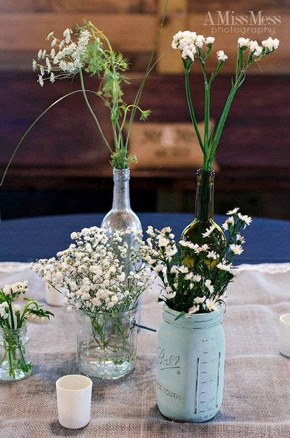 Simple Centerpieces - Keep it simple with small bunches of blooms arranged in vessels of varying heights