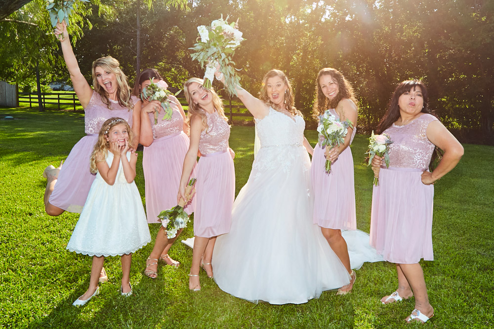 Bridal Party Portraits - Take advantage of warm spring weather and snap a few shots of the bridesmaids and groomsmen in the great outdoors