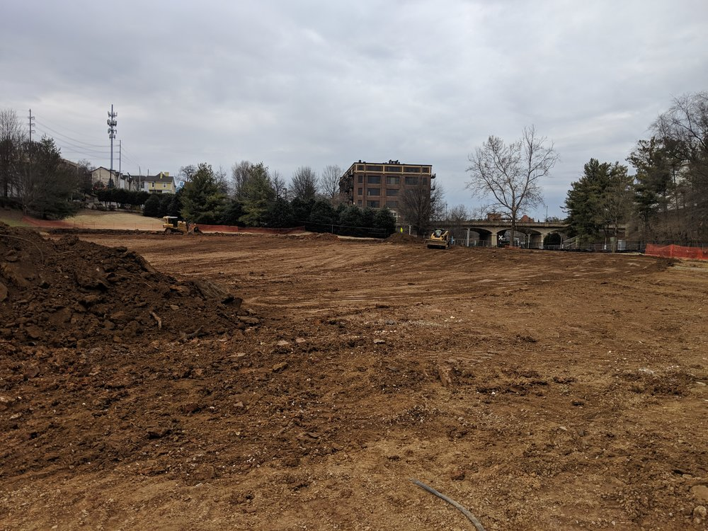 Rough grading preps the site for irrigation and drainage installation.