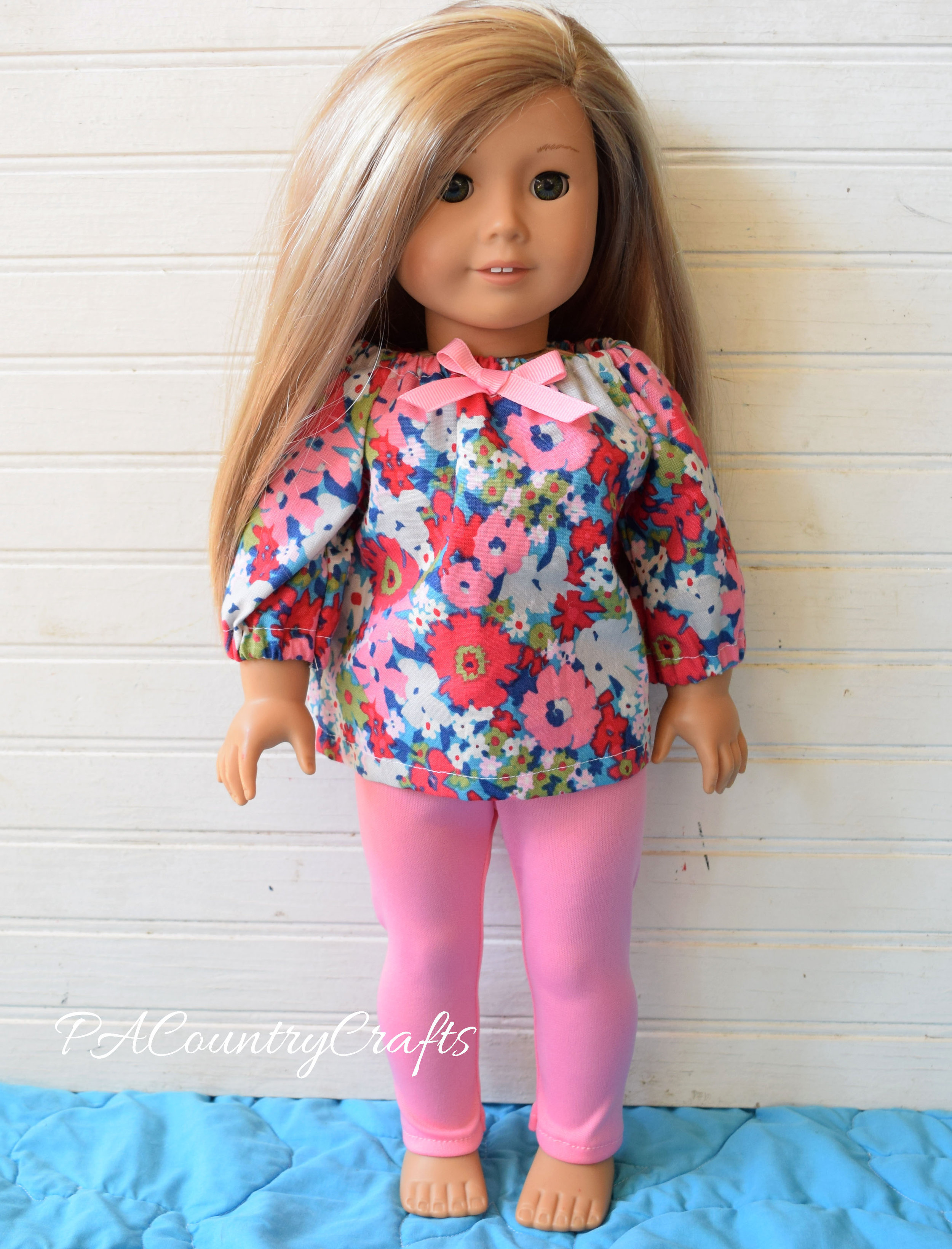 flowered doll top and pink leggings