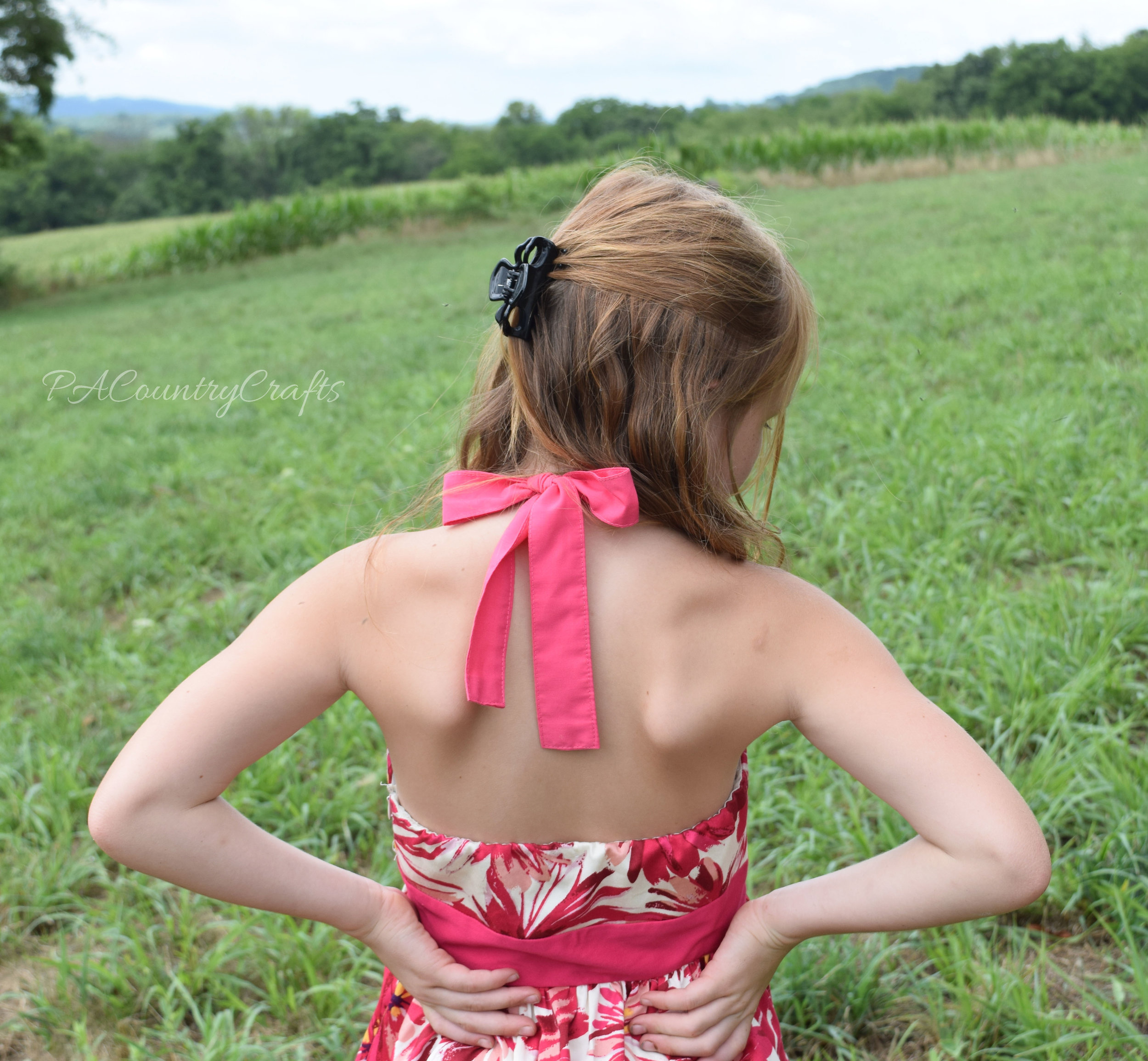 Add halter ties to a women's strapless dress.