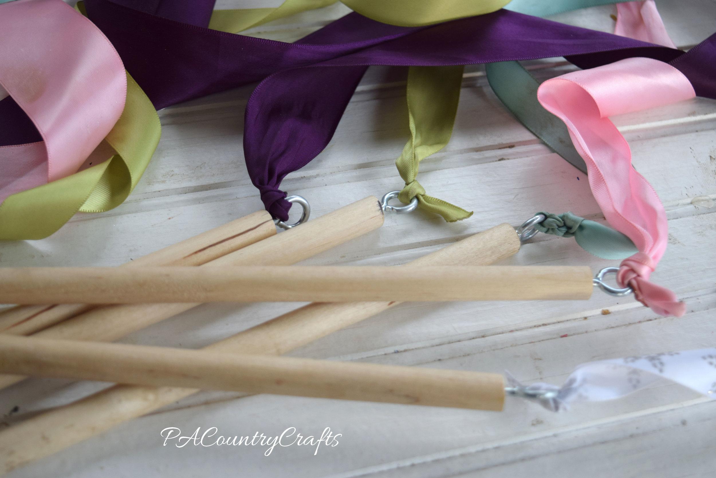 Ribbon wands using eye hooks