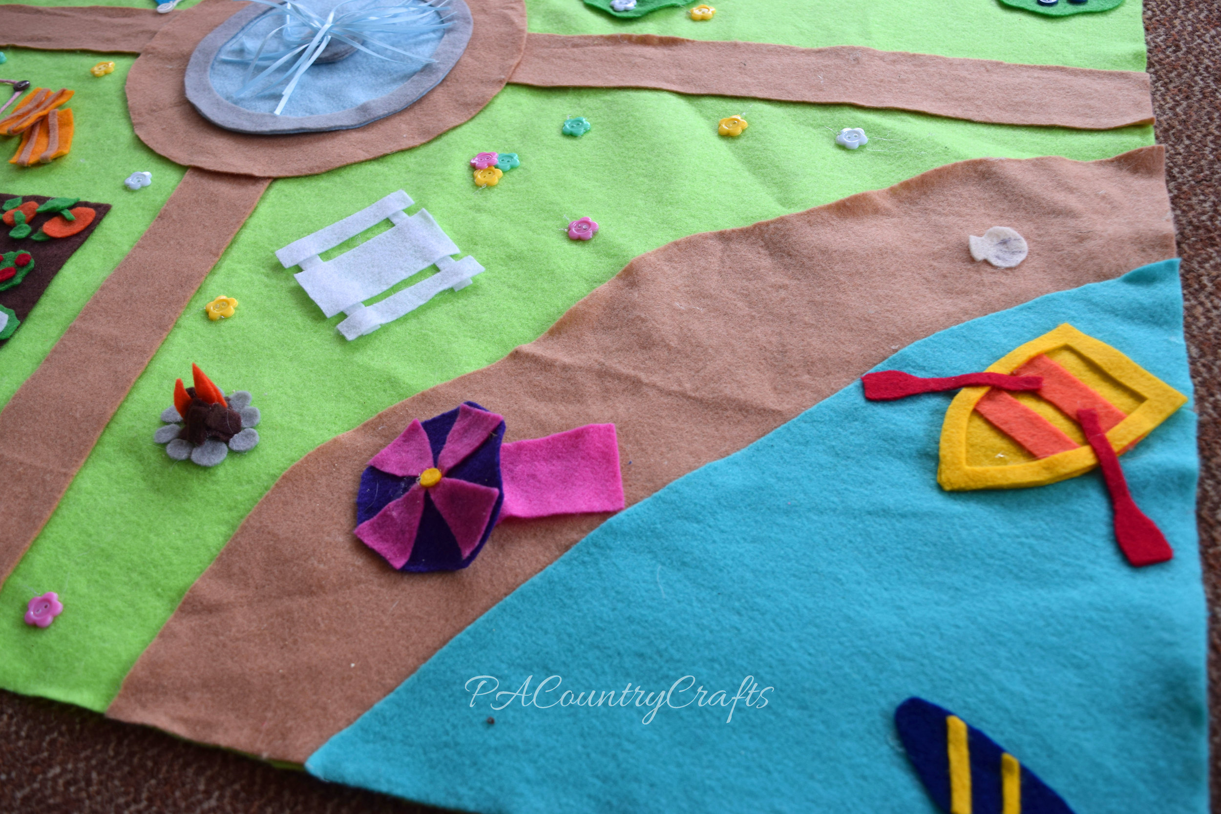 No-sew felt play mat with a beach scene.