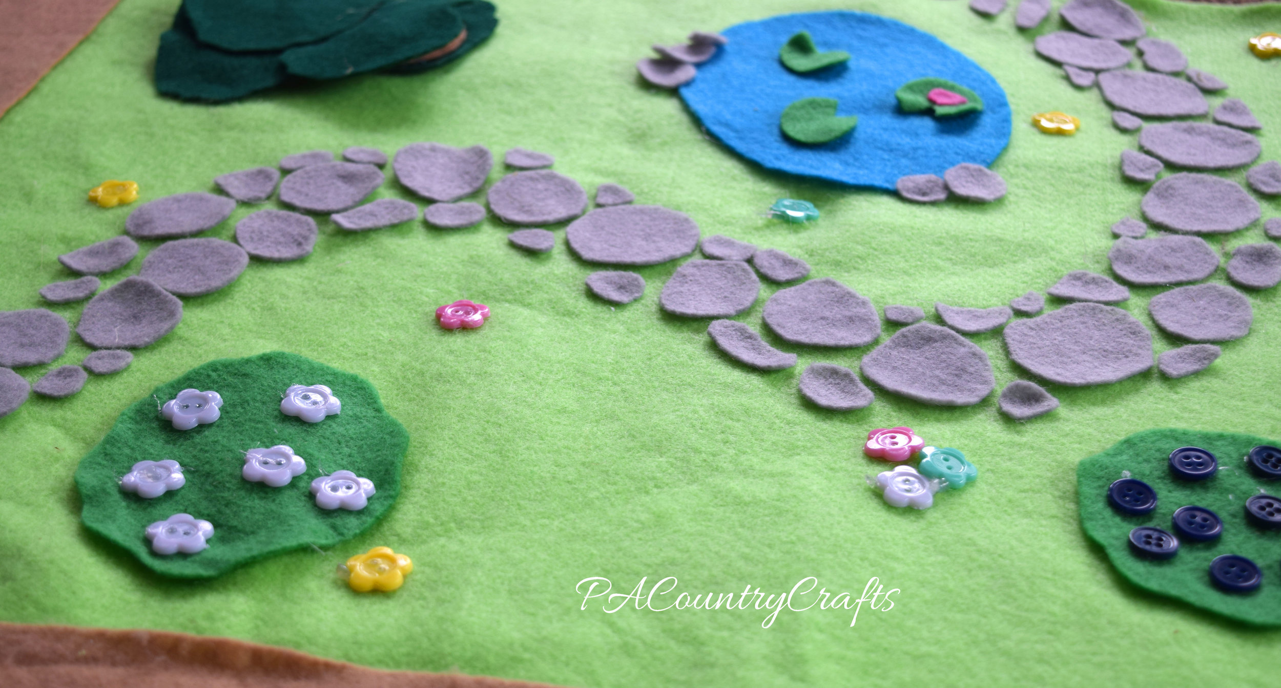 Make a felt cobblestone path by hot gluing gray circles
