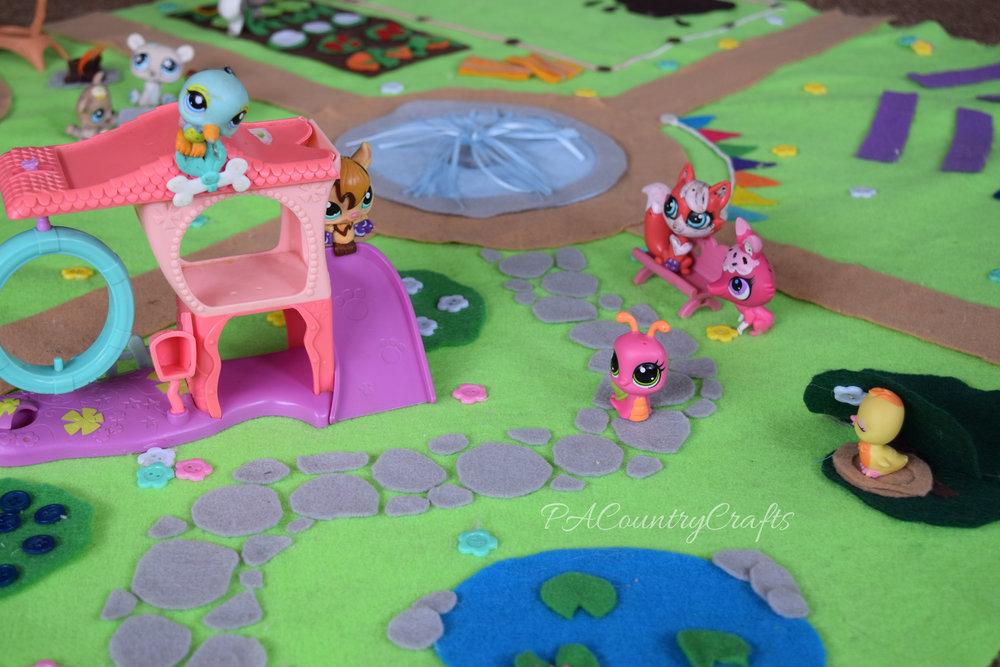 Littlest Pet Shop toys on a DIY felt play mat