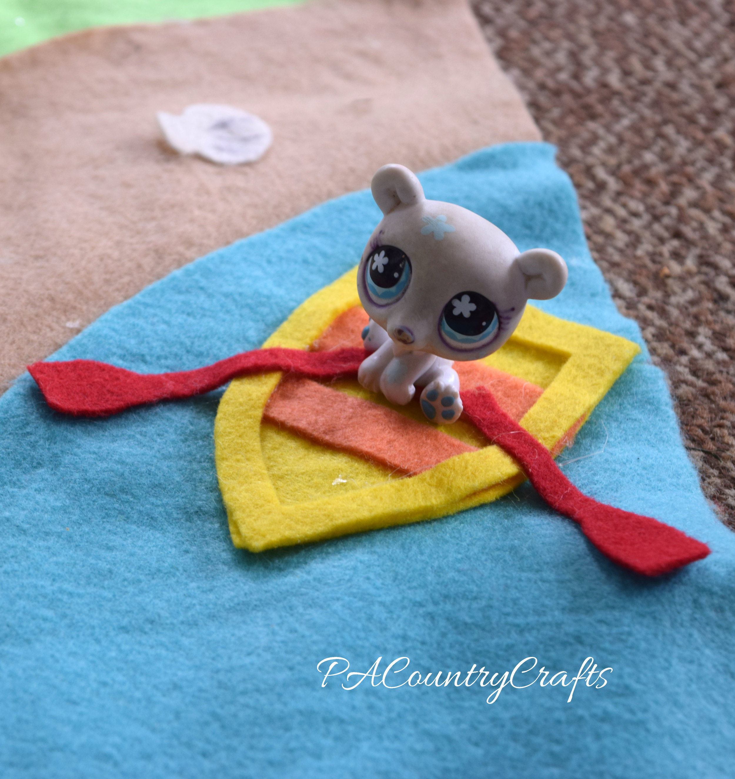 Felt boat in a beach scene play mat.