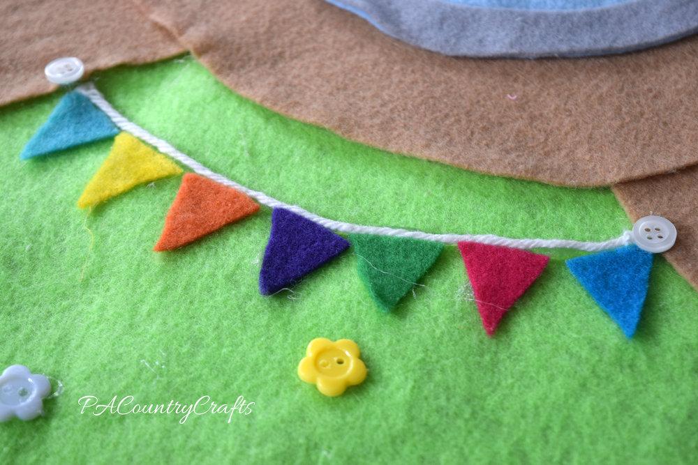 felt triangles and yarn make a felt bunting