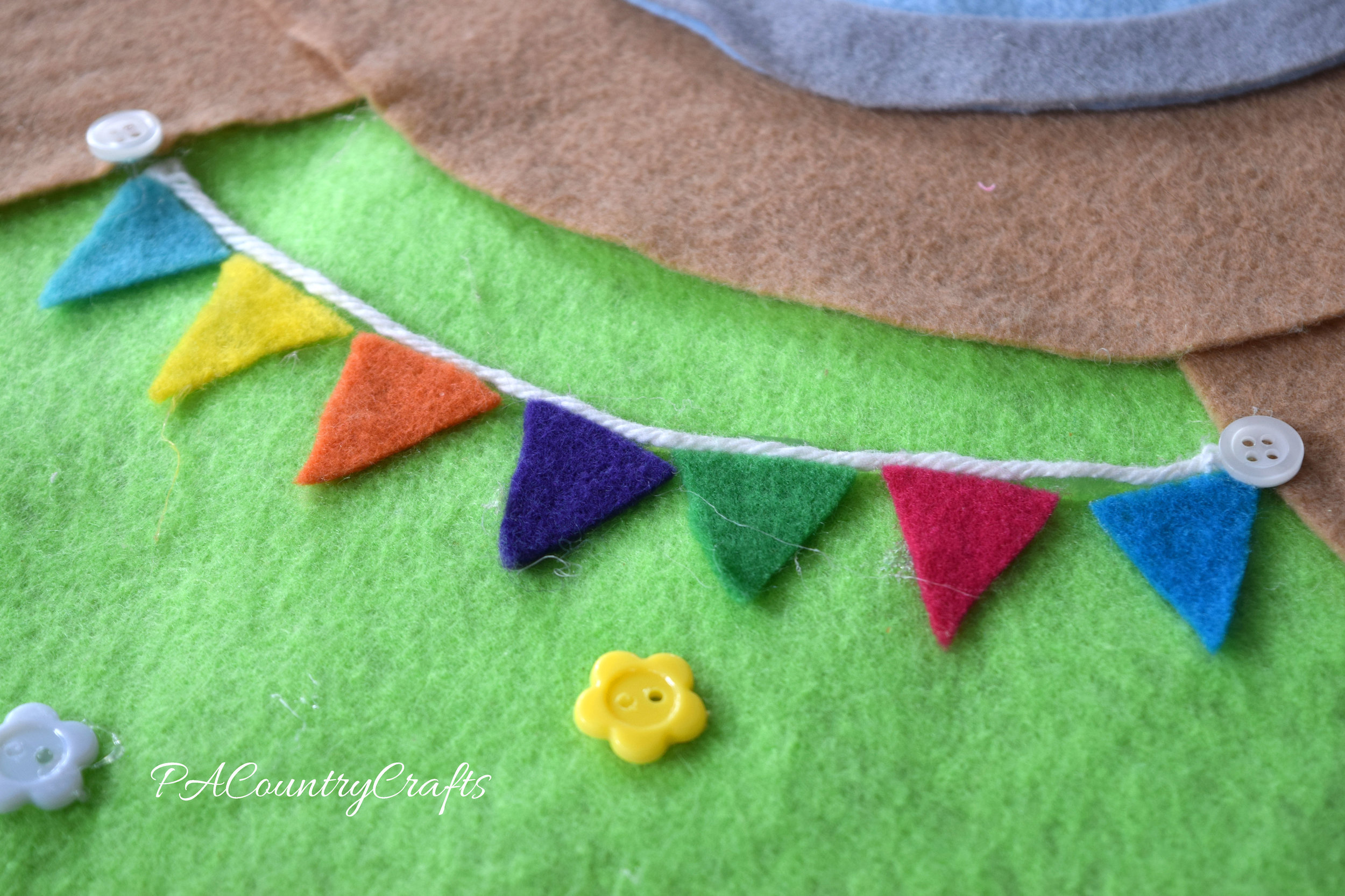 felt triangles and yarn make a felt bunting