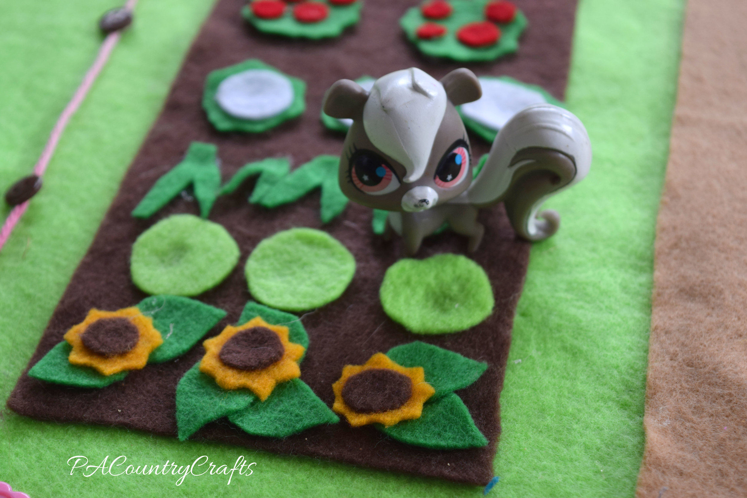 felt sunflowers in a garden