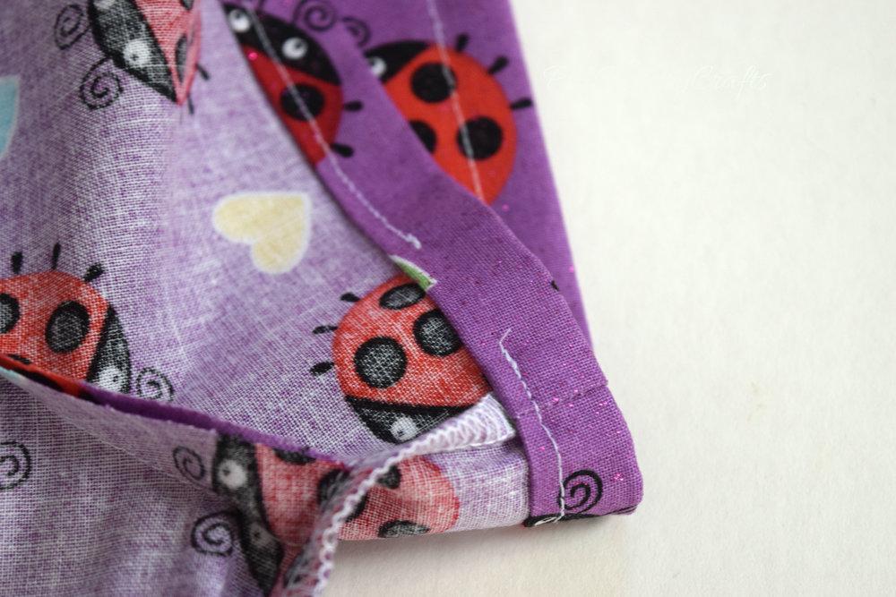 Sew elastic casings for peasant dress sleeves.