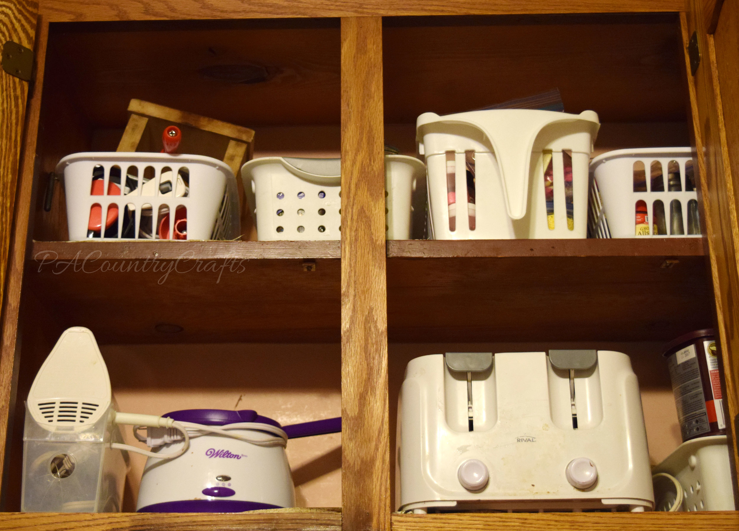 How to organize high cupboard shelves with plastic bins.