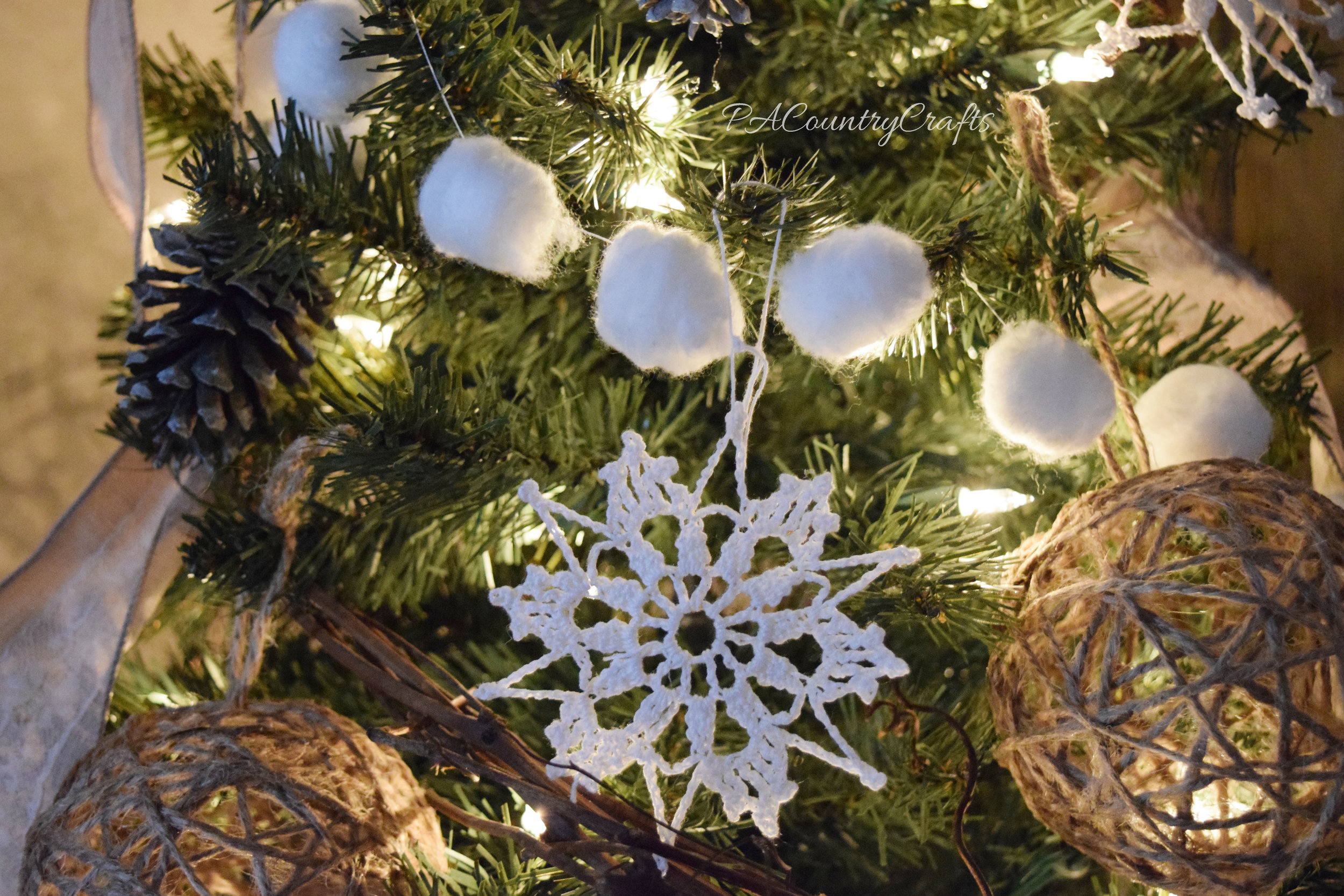 Crochet snowflakes and snowball garland made from cotton balls