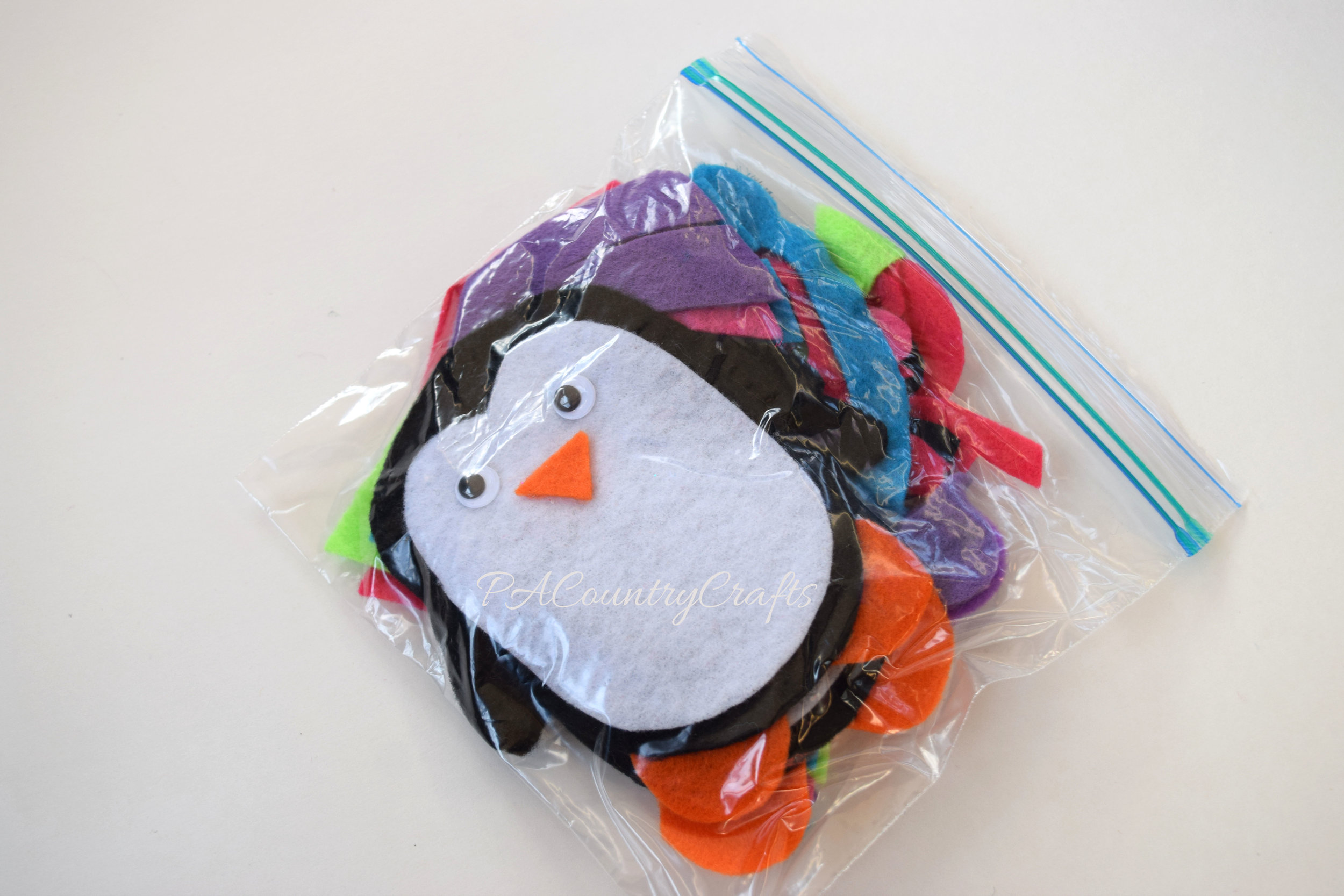 felt penguin busy bag