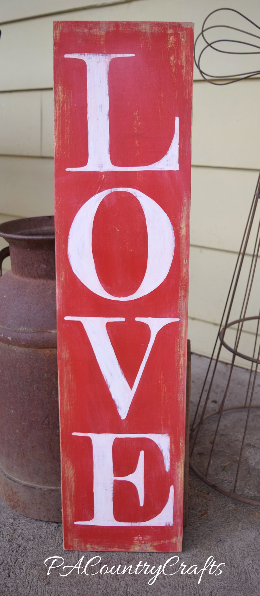 Turn and old board into a hand painted LOVE sign for your porch.