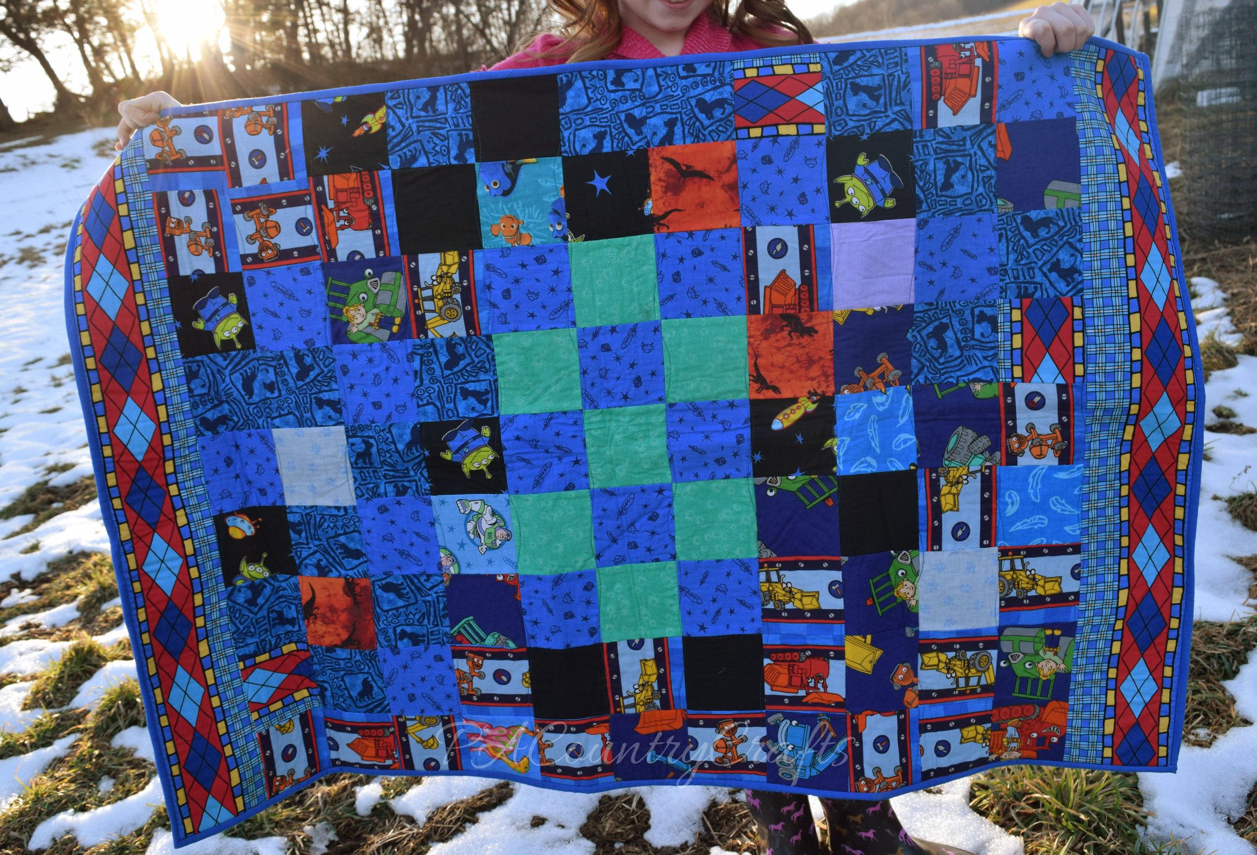 character fabric scrap quilt