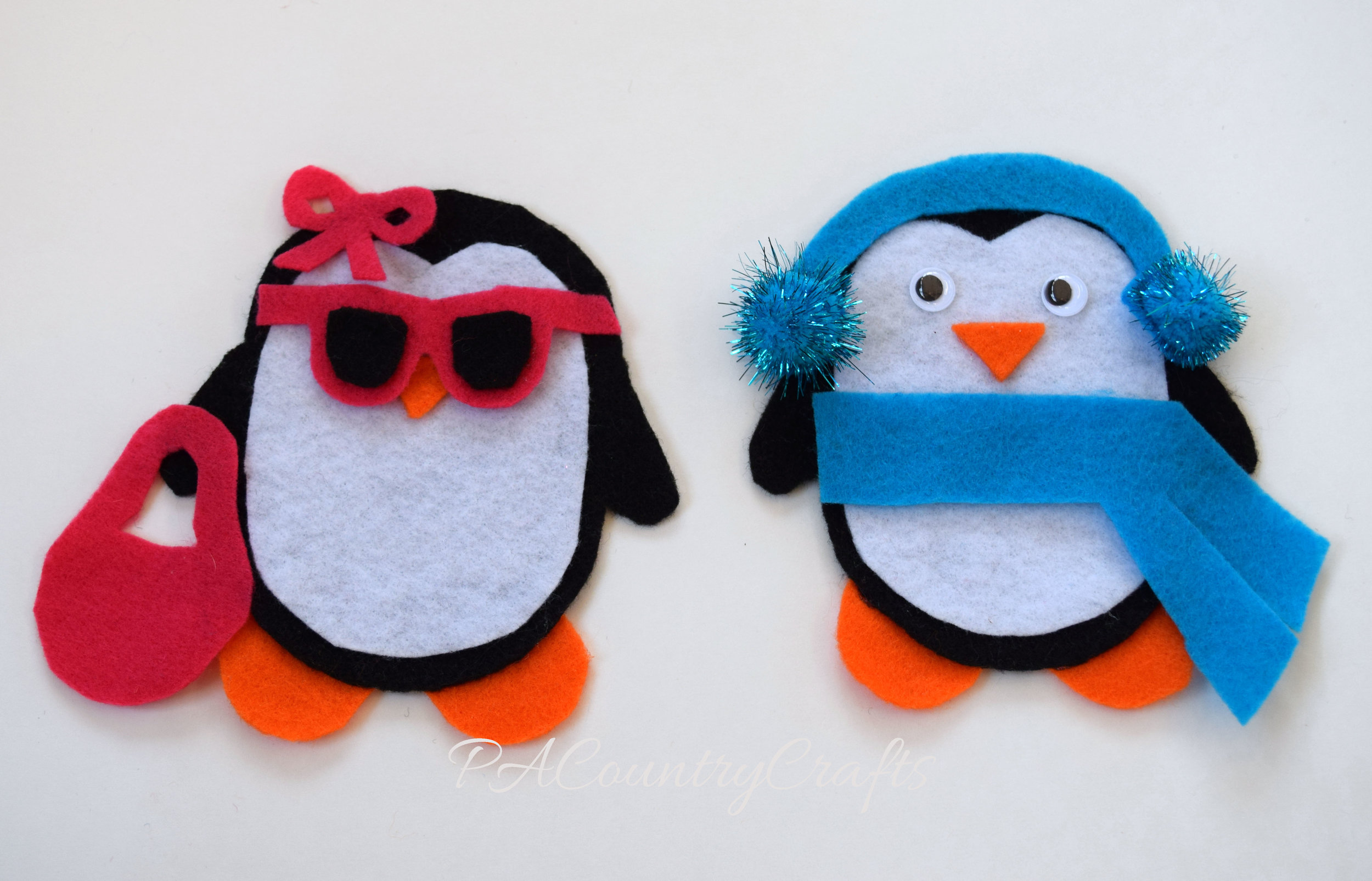 Toddler activity- play dress-up with felt penguins.