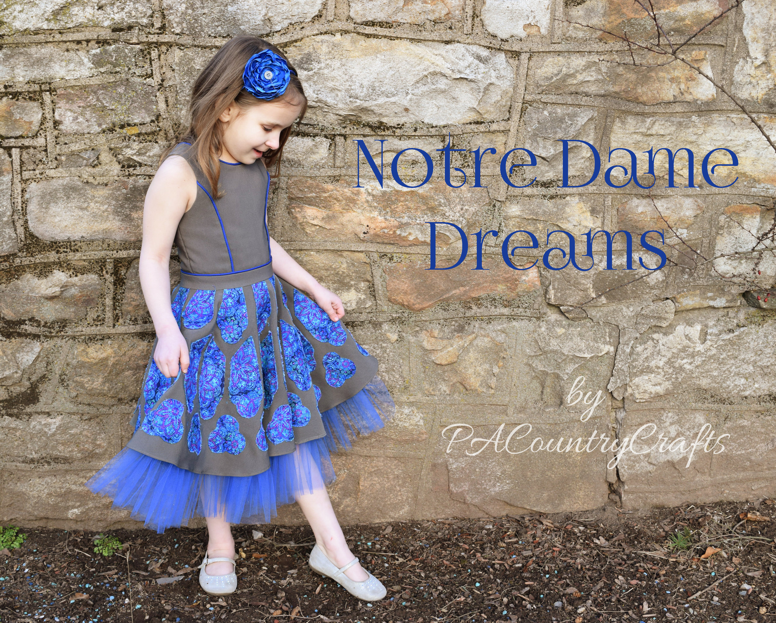 A Notre Dame cathedral inspired dress with an applique circle skirt.