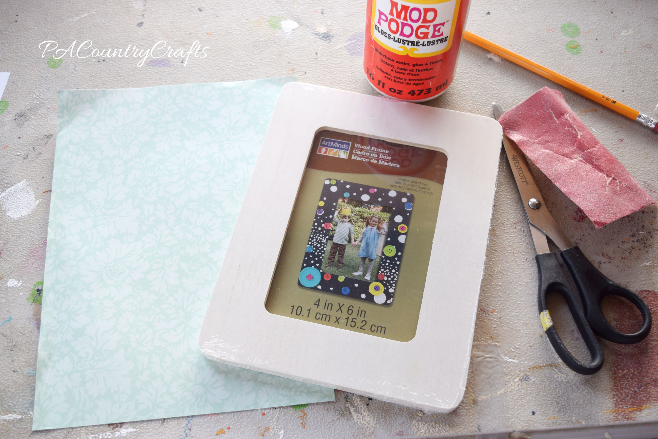 Easy DIY frame craft with scrapbook paper, cheap wood frames, and mod podge.