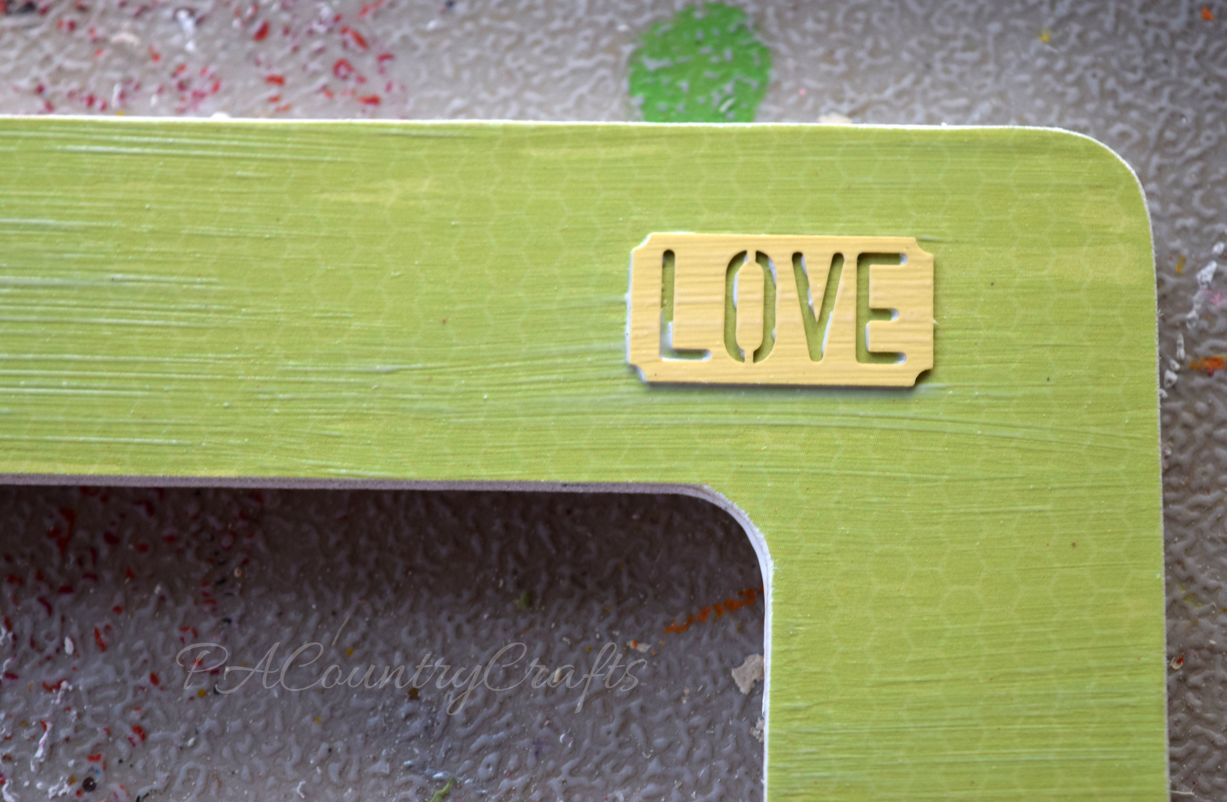 Cute embellishments on a DIY frame. Mod podge is great!