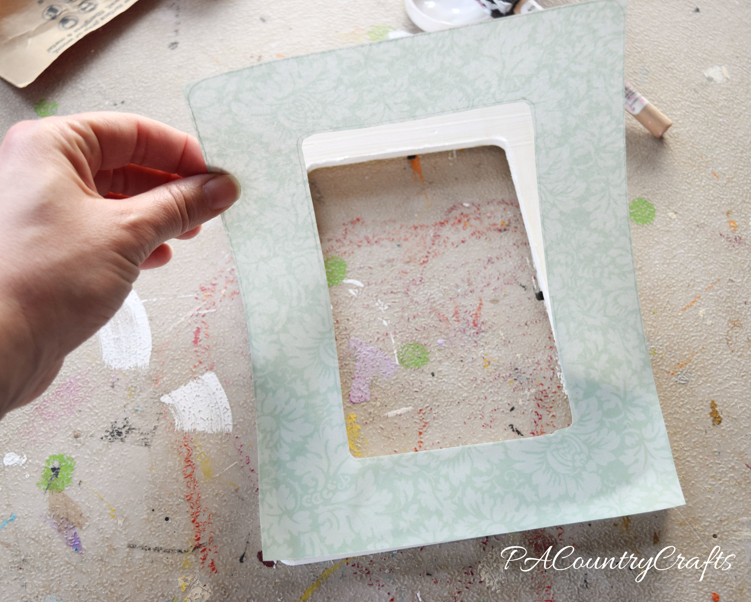 How to cover a wooden frame with paper