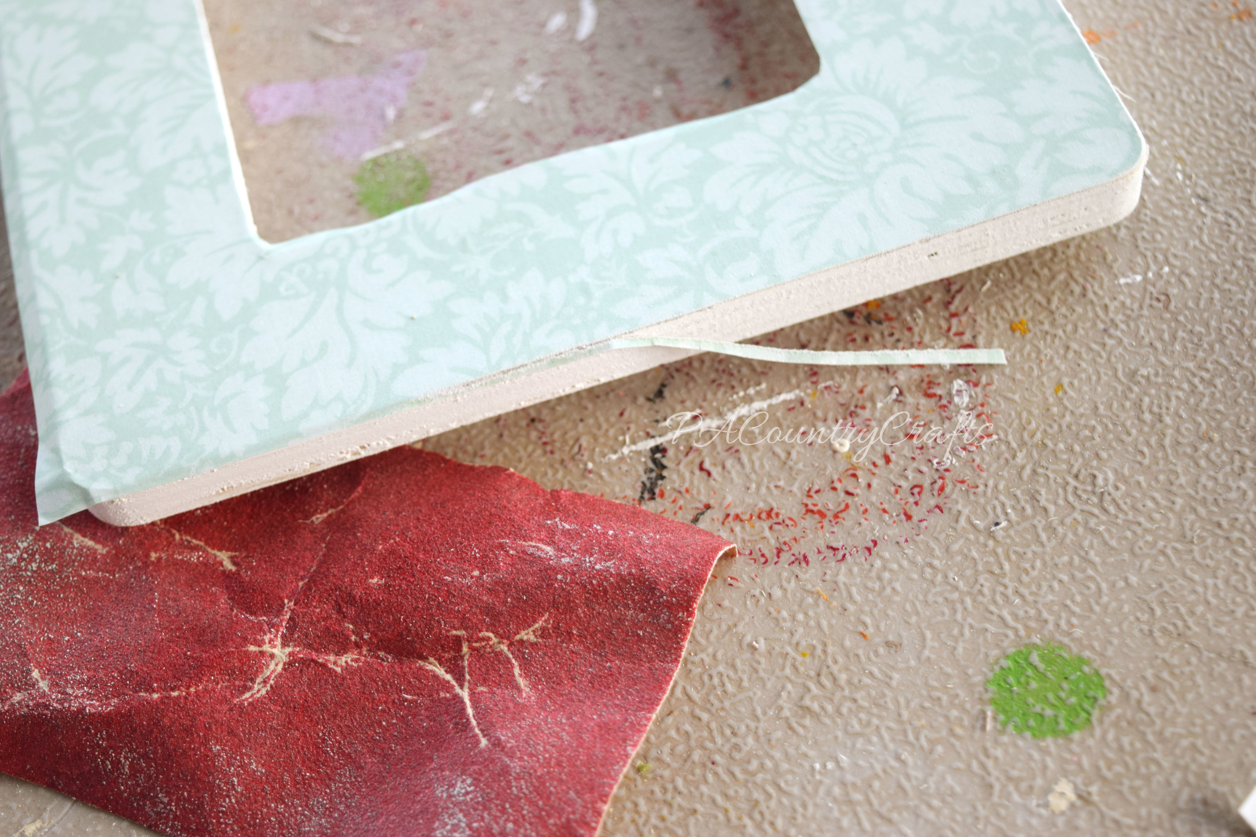 The secret to getting perfect edges on mod podge picture frames...