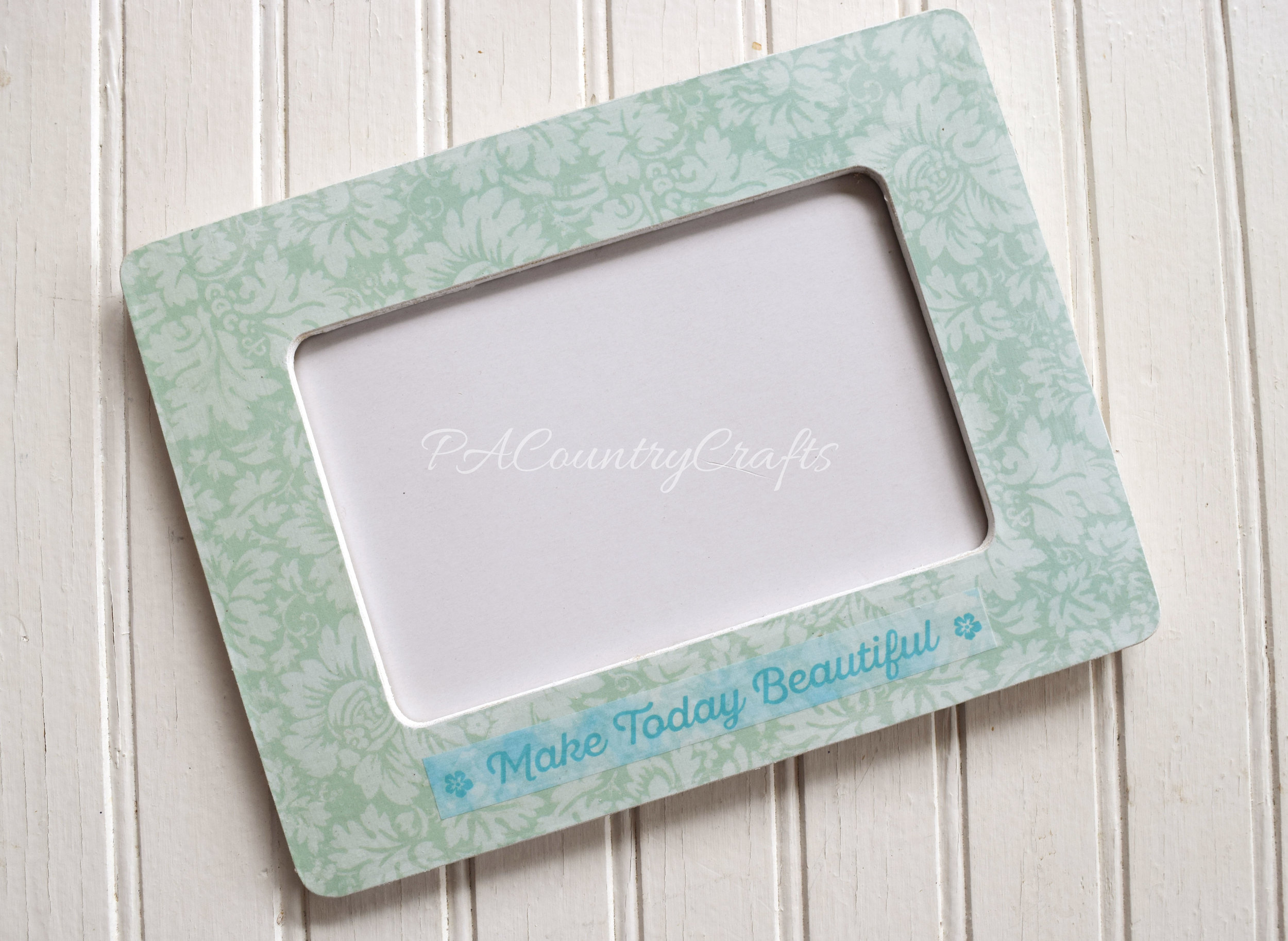 Mod podge, scrapbook paper, and washi tape make this cute frame!