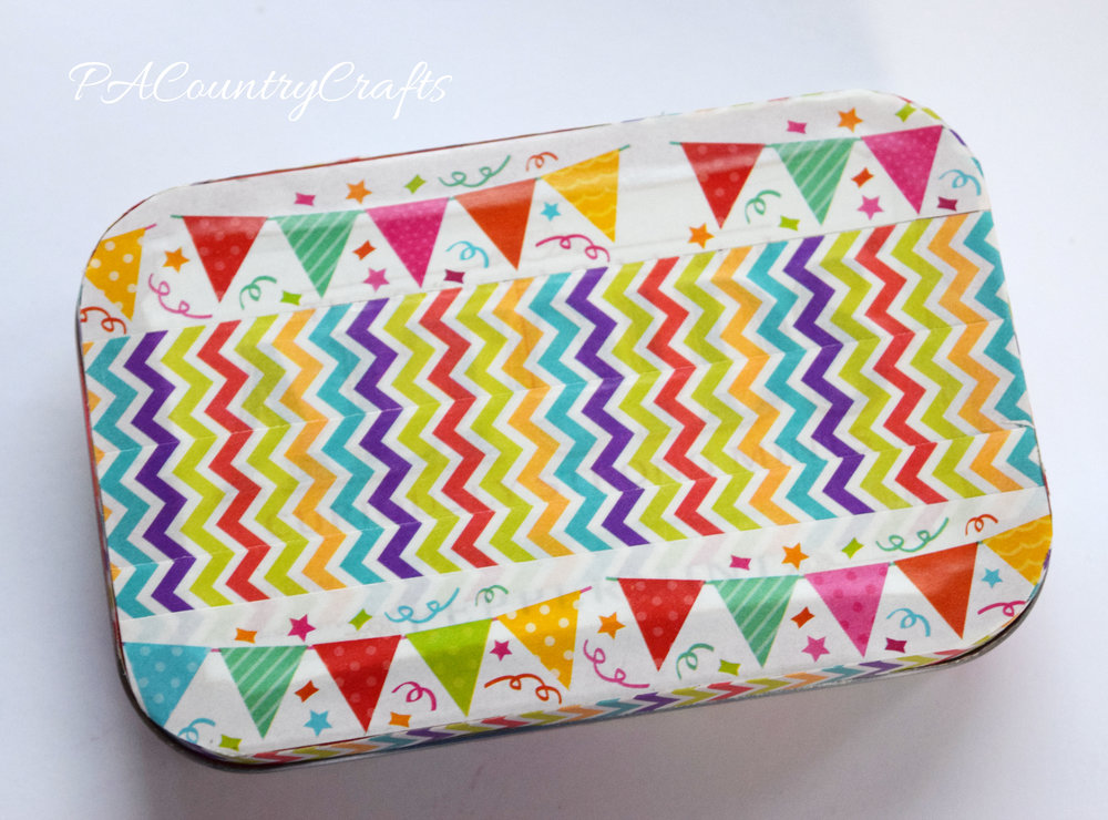 I love washi tape! Use it to decorate and old Altoid Tin and make it cute!