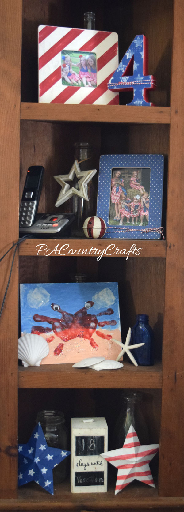 July 4th home decor on a corner shelf