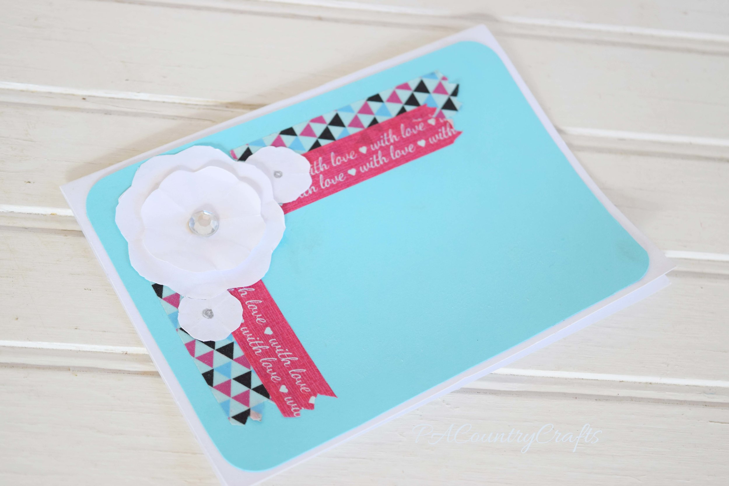 Cute flower embellishment on a blank card with washi tape!