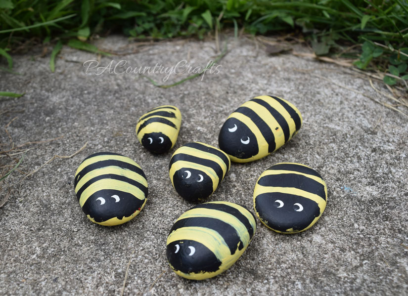 Let kids paint simple bee rocks for a fairy garden.