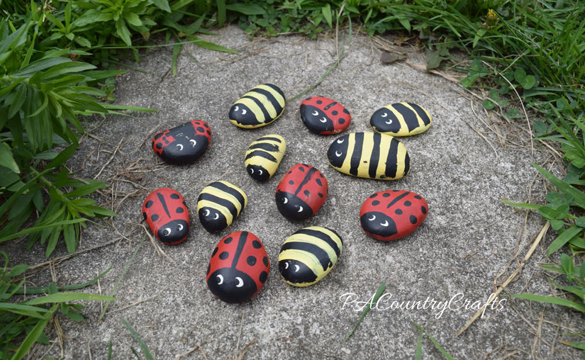Ladybugs and bumblebees painted on rocks- great summer kids craft!