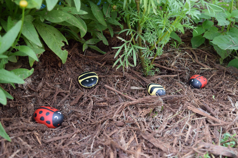 Painted rocks to brighten up the flowerbeds!