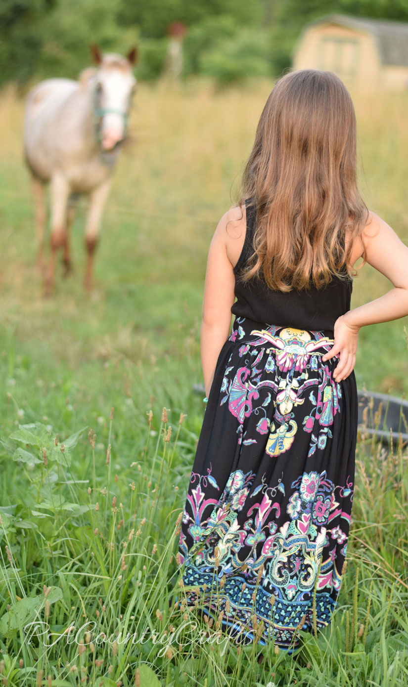 Make a girls' maxi skirt from a women's border print dress!