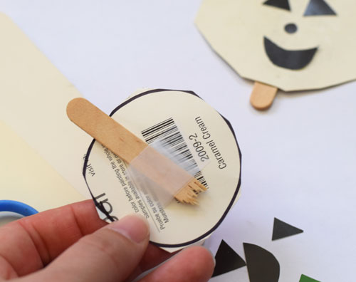 Popsicle sticks and paint chips to make jack-o-lanterns!