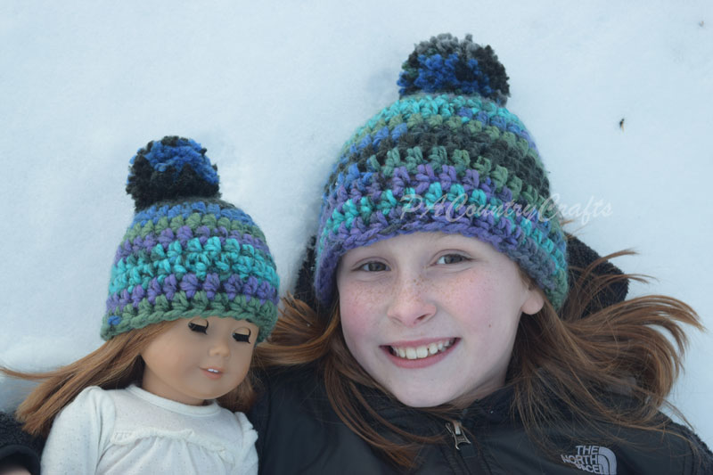 Matching crochet girl and doll hats with a simple, free pattern.