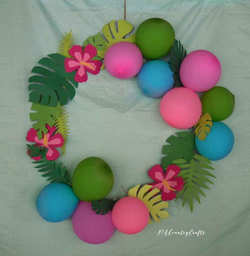 Giant tropical wreath for beach party decor- uses paper leaves and balloons!