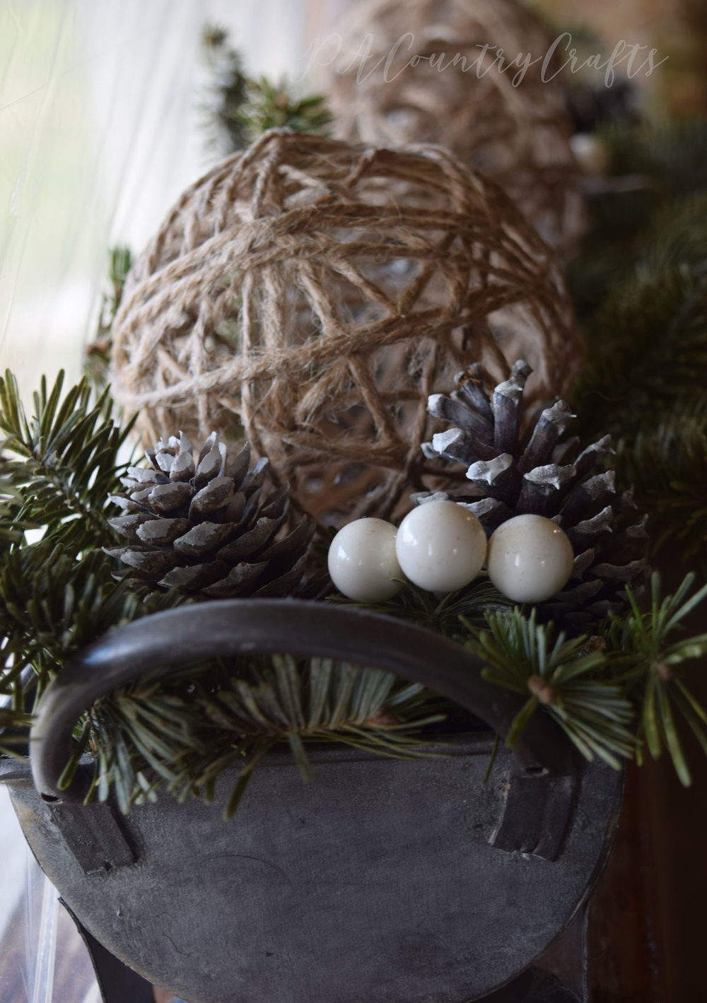 Rustic winter decor with twine balls and pine cones