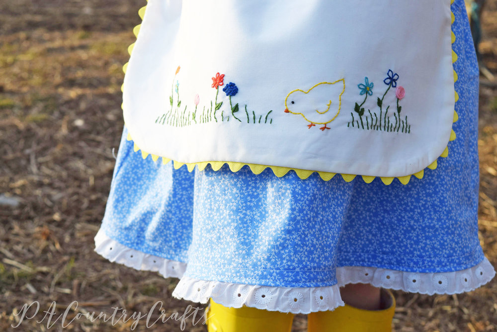 vintage style embroidered apron inspired by a child's drawing