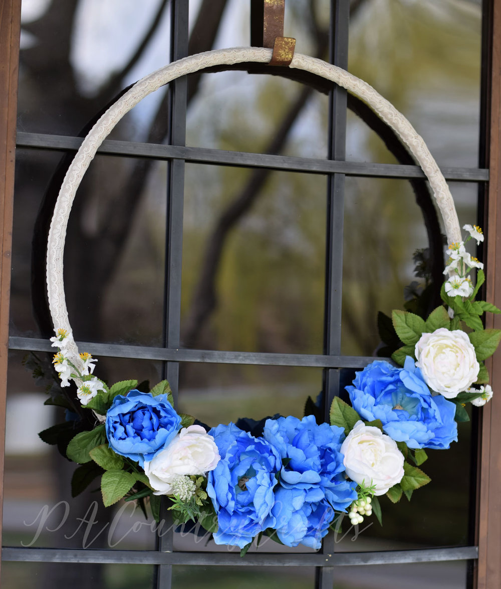 Spring wreath made from a dollar store hula hoop!