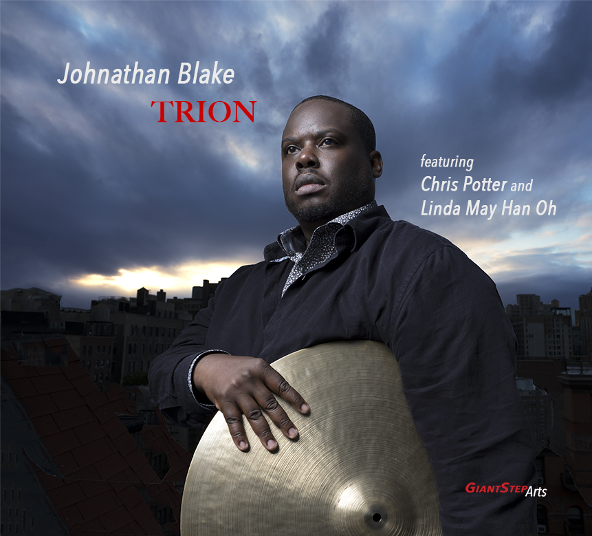 "Drummer Johnathan Blake to release  Trion , an exhilarating chordless trio outing captured live with fellow modern jazz greats Chris Potter and Linda May Han Oh     Blake's double album available April 5, 2019, is the second release from Jimmy Katz's Giant Step Arts, a groundbreaking, artist-focused non-profit with a single mission:    to help modern jazz innovators create their art free of commercial pressure     ""Johnathan Blake is a drummer equally capable of muscular propulsion and subtle shading.""  – Nate Chinen, New York Times    ""[Blake's] playing is furious but never overpowering, always alive with inner detail, galvanizing the players in his midst.""  – David R. Adler, The New York City Jazz Record   One of the most in-demand drummers of his generation,  Johnathan Blake  takes an all-too-rare turn as a leader with his vibrant new release,   Trion  . The album, captured live before a thrilled audience at New York City's renowned  Jazz Gallery , features a virtuoso chordless trio with two fellow masters of their instruments: the modern tenor giant  Chris Potter  and the eloquent bassist  Linda May Han Oh .  Trion , packed with nearly two hours of thrilling, exhilarating music, will be released  April 5, 2019  thanks to the groundbreaking new non-profit  Giant Step Arts , led by noted photographer and recording engineer Jimmy Katz.  Though Blake's name is on the cover, he approached this trio date with the same sense of open camaraderie with which he enters into any musical situation – the collaborative spirit that makes him such a remarkable drummer. The album's title is taken from a physics term that refers to three atoms combining to form a single unit, a concept that is deeply meaningful in the context of this highly attuned trio.  Blake initially put this trio as a collective which called itself the BOP Trio, inspired by the initials of each member's last name. Their instant chemistry stemmed from extensive playing together in other situations: Blake had worked in similar chordless settings under Potter's leadership along with Larry Grenadier and Ben Street, and with Oh in trios with Mark Turner and Jaleel Shaw.  ""I'm in awe of both Linda and Chris,"" Blake says. ""This was a really beautiful chance for us to make some honest music together and I really enjoyed the process. We all felt very comfortable in the chordless format; we really know how to fill up the space without getting in each other's way, which gives each one of us the opportunity to have our shining moments.""  When Katz approached him with the offer to record, Blake says, ""I was almost in shock. It's almost unheard of for artists nowadays to own their own project if they sign with a record label. Jimmy and [his wife and partner] Dena Katz have always been strong advocates for the music and they just want the best artistic project out there. Their idea is that if the project is really good, it's not only a reflection of the artist but it's also a reflection on them. I think they're really visionaries in that respect.""  Both of  Trion 's two discs opens with a solo drum feature by Blake; the expressive ""Calodendrum"" is named for an evergreen tree native to Africa, reflecting the drum language's roots on the continent, while ""Bedrum"" is a word that means ""to drum about in celebration,"" which couldn't be more appropriate for Blake's joyful percussion explosions.  The band initially enters via Potter's arrangement of The Police's frenetic ""Synchronicity I,"" which showcases the trio's brilliant attack and sustained intensity, stretching out over an enthralling and invigorating 17 minutes. Oh's deeply moving solo leads into her own moody piece ""Trope,"" built on her brooding bass throb and a sinuous melody beautifully expressed by Potter.  Potter contributes two pieces; the composer sets the pace for the lively bounce of the South African-inspired ""Good Hope"" by using his sax keys as percussion instruments, while the weightless lines of ""Eagle"" soar with seemingly effortless grace. Blake's own originals look back to his early days in Philadelphia. ""West Berkley St.,"" named for the street where Blake grew up in the city's Germantown section, and ""High School Daze"" both groove with the influence of the funk and hip hop tunes he heard alongside jazz, while the latter adds in a few unexpected swerves that suggest the stupor of wandering from classroom to classroom. ""No Bebop Daddy"" was inspired by saxophonist Donny McCaslin's young son, who would loudly protest his father's choice of music from his car seat on morning rides to school.  Blake's own father, the late jazz violinist John Blake Jr., is represented by his ""Blue Heart,"" a previously unrecorded composition. ""Since he left us in 2014 I've made it a point to continue to celebrate my father's life and legacy,"" Blake says. ""It's a way for me to continue to let people know about this man who was such a great artist and beautiful human being.""  Bassist Charles Fambrough was a family friend and a collaborator with John Blake Jr. in the McCoy Tyner band. Fambrough's ""One for Honor"" was originally recorded on Tyner's 1980 album  Horizon , and later on the bassist's own 1991 release  The Proper Angle . ""Charles basically knew me from birth and was one of the first people to give me a professional gig when I was still living in Philadelphia. He was like an uncle to me, and I want his music to live on and people to know about this amazing musician who left us way too soon.""  The trio's take on Charlie Parker's classic ""Relaxin' at Camarillo"" was unplanned, an on-the-spot decision when the Jazz Gallery audience demanded an encore. Its muscular swing and infectious exuberance, especially coming on the spur of the moment, reveals the three musicians' love for playing together along with their spirited virtuosity.  ""A lot of magic and beauty can come out of the freedom to explore that Jimmy granted us,"" Blake says. ""I think the reason the music sounds the way that it does is because there was so much trust and freedom.""    Johnathan Blake   Johnathan Blake, one of the most accomplished drummers of his generation, has also proven himself a complete and endlessly versatile musician — ""the ultimate modernist,"" as John Murph of NPR has dubbed him. Blake's gift for composition and band leading, so ably demonstrated on his 2012 recording debut  The Eleventh Hour , reflects years of live and studio experience across the aesthetic spectrum. Through years-long memberships in the Tom Harrell Quintet, the Kenny Barron Trio and other top ensembles, Blake has reaped the benefits of prolonged exposure to the greats of our time — arguably of all time. Through his powerful, evocative drumming and fully rounded artistry, he's also left a huge imprint on the music of such rising figures in jazz as Hans Glawischnig, Alex Sipiagin, Donny McCaslin, Avishai Cohen, Omer Avital, Patrick Cornelius, Michael Janisch, Shauli Einav, Jaleel Shaw and more."