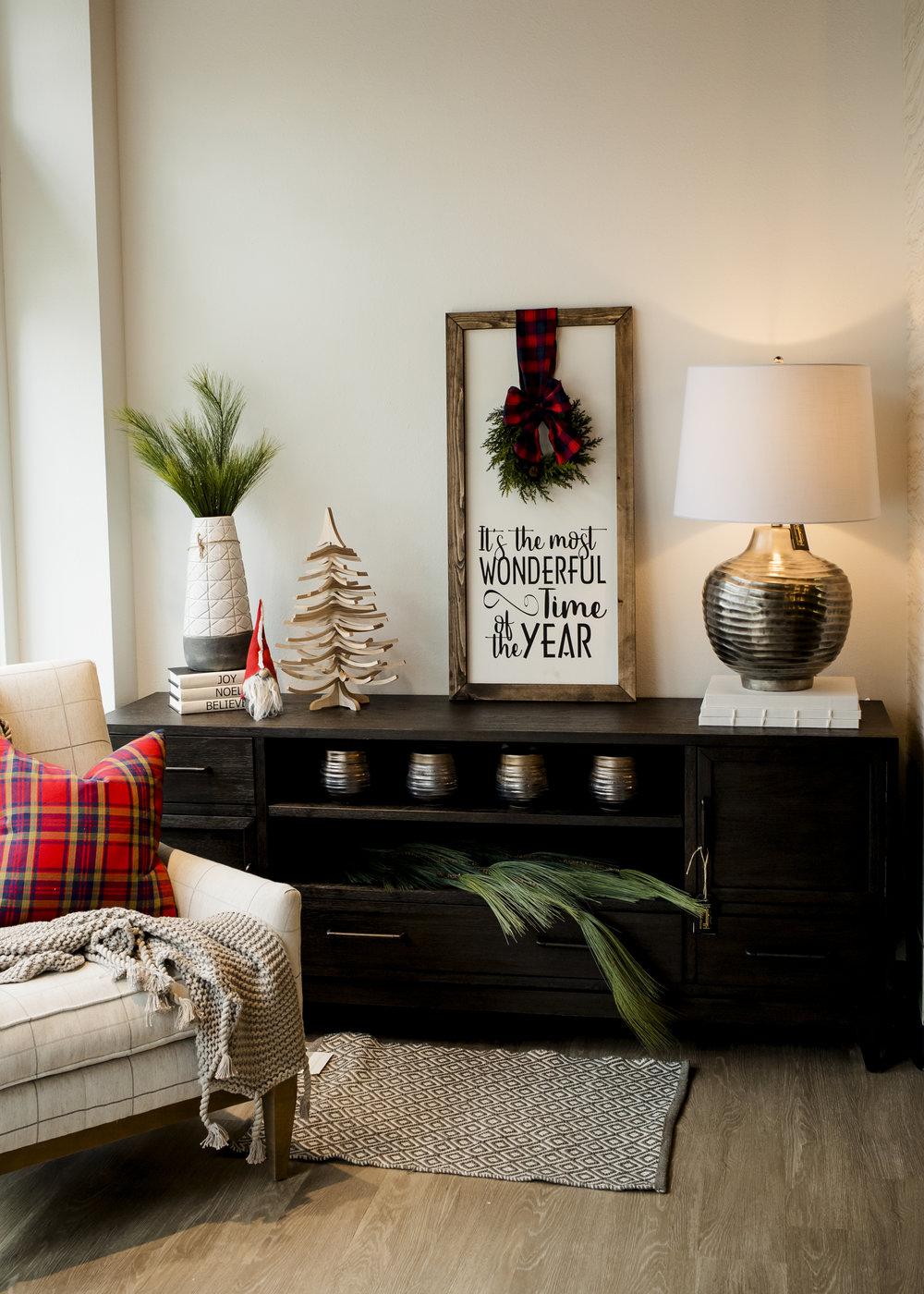 Swivel Tree $34, Santa Gnome $13, Harrier Gray Vase $75, Pine Spray $7.50, Joy/Noel/Believe Books $37/ec, Long Needles Pine Hanging $44, Accent Rug $56, Gray Organic Cotton Throw $145, Plaid Pillow $41.50, Make & Take Wonder Sign $65, Pots $14.50/ec