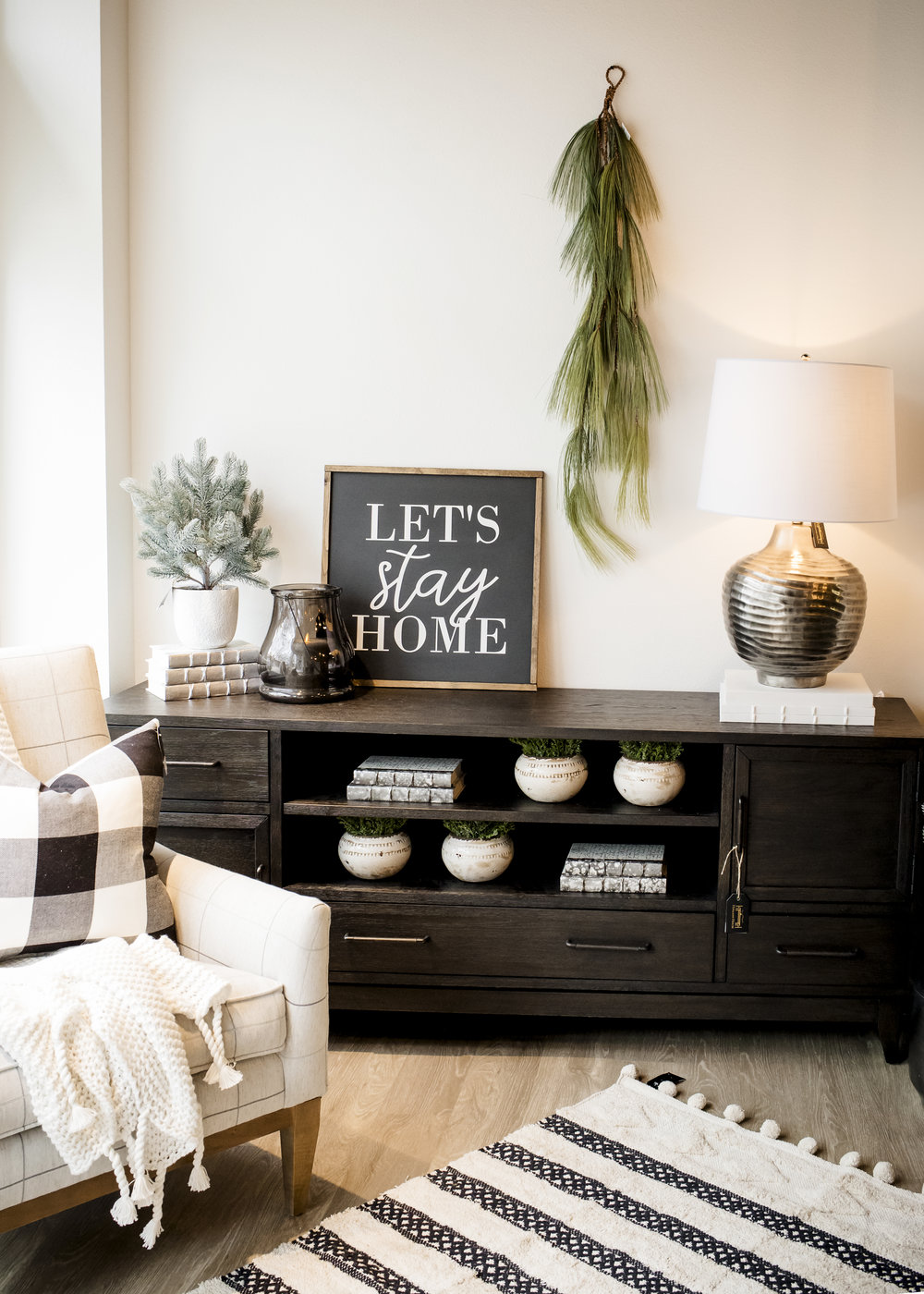 Silver Spine Books $42/ec, White Callie Vase $12.50/ec, Battery Powered & Timer option Platinum Candle $44, Blue Spruce $42, White Organic Cotton Throw $142, Cotton Woven Black/White 3x5 Rug $99, Buffalo Plaid Pillow $41.50, Let's Stay Home Sign $71