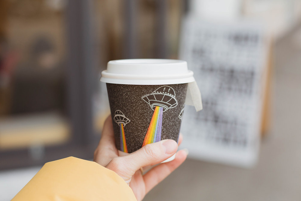 to go cup art designed by Robbins and illustrated by local artist Ella Duret