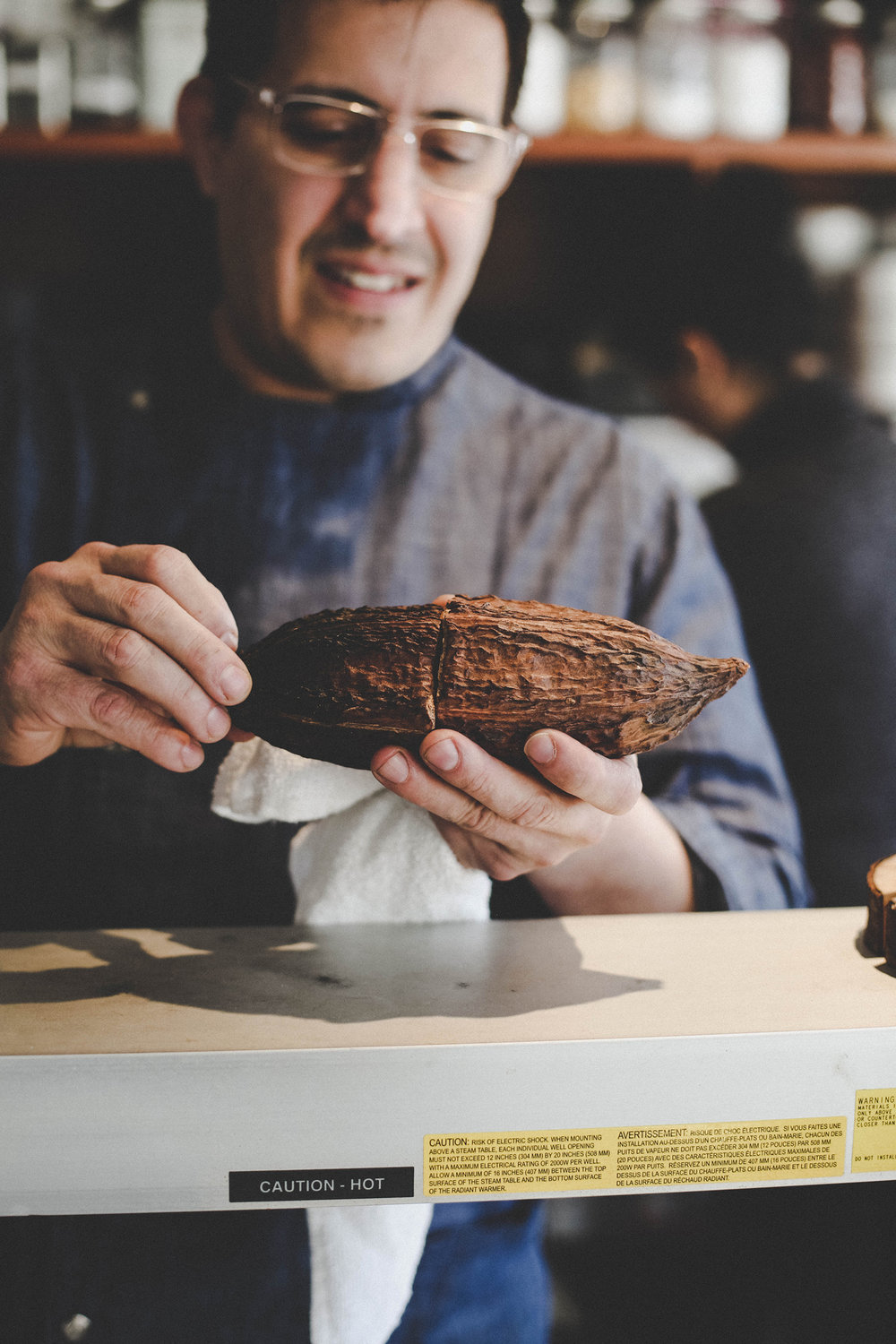 The cacao beans from inside have been used in his dishes.