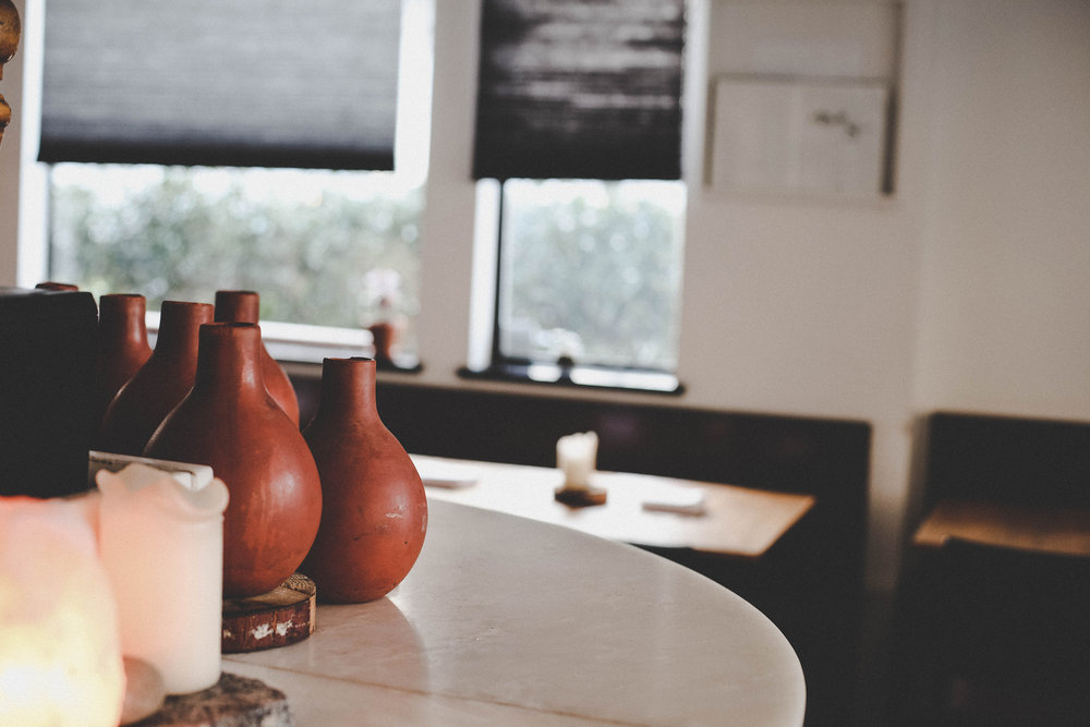 Handmade terracotta jugs filter impurities out of water and keep it at a cool temperature.