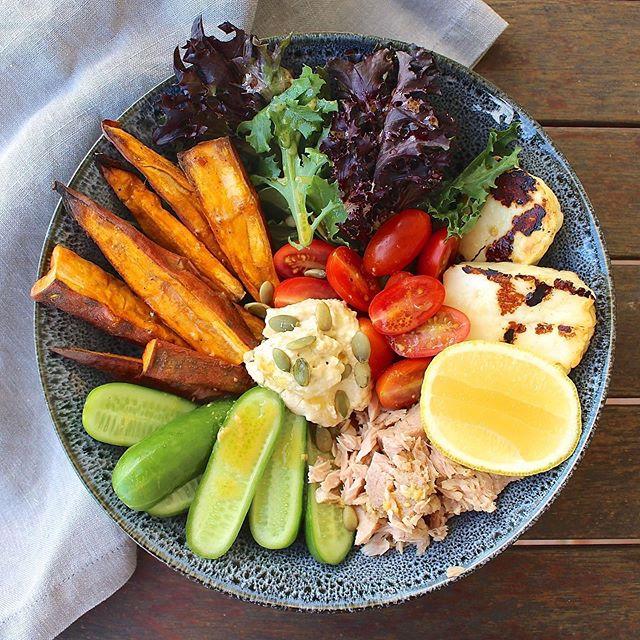 The perfect work from home lunch❣️Roasted sweet potato + haloumi + hummus + tuna + allll the veggies 🍠🥒🍅🌿